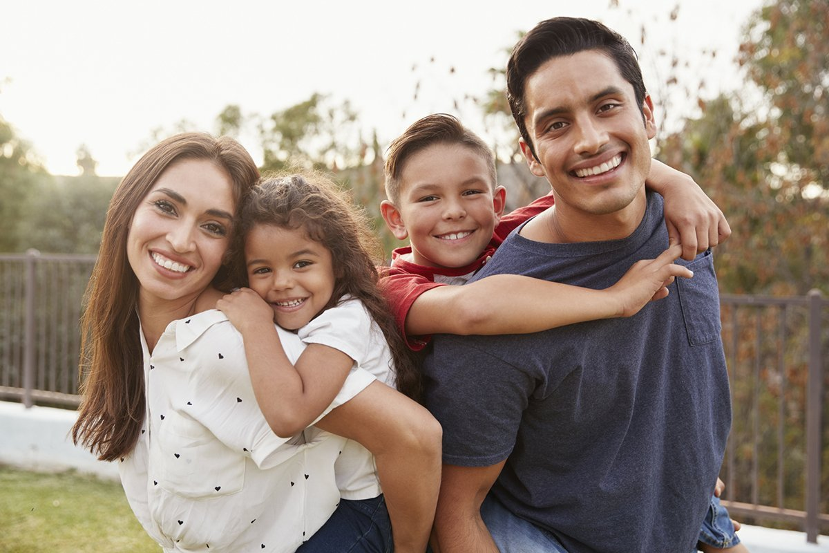Young Hispanic parents with two children